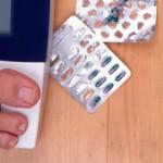 Balança e remédios emagrecedores