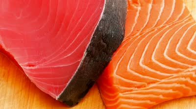 stock-footage-fresh-raw-salmon-and-red-tuna-fish-pieces-over-wooden-board-shallow-dof-x-intro-motion