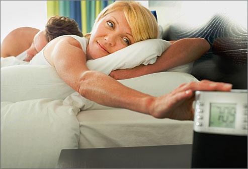 getty_rf_photo_of_woman_turning_off_alarm_clock
